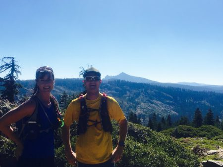 Abbey and Pete on PCT with Sierra Buttes behind